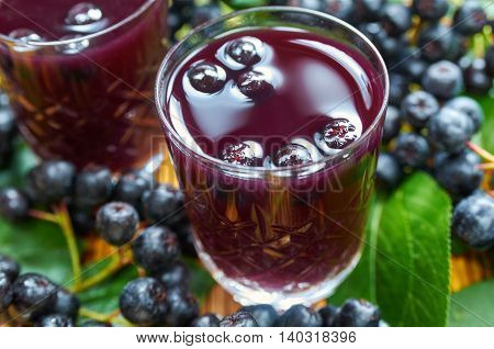 Sweet liqueur made from chokeberry and alcohol