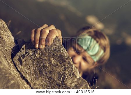 Young man finishing his extreme mountain climb