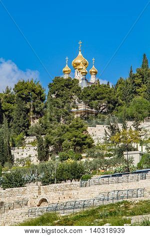 Golden domes of Russian Orthodox Church of St. Mary Magdalene on the Mount of Olives in Jerusalem. Vertical
