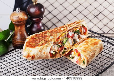 shawarma still life on a plate meat chicken cabbage carrot onion pepper Isolated white background thin lavash