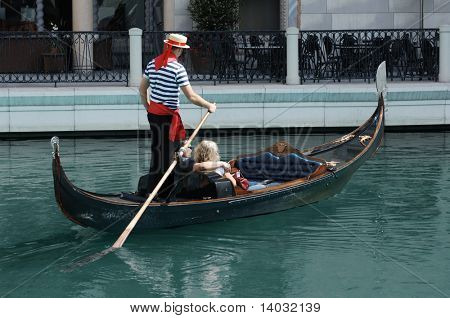 Couple having a romantic ride down a canal in a gondola