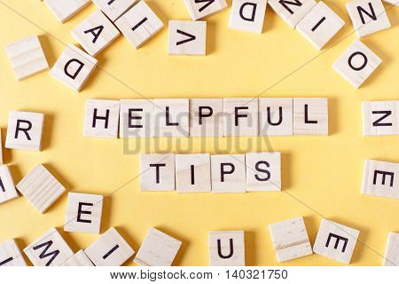 Helpful Tips word written on wood block. Wooden ABC.