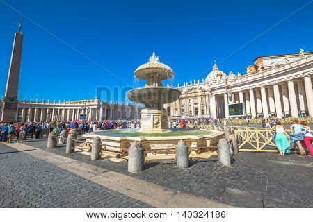 Rome, Lazio, Italy - June 18, 2016: San Pietro Italian fountain and Saint Peter basilica, in Rome in Italy, during the Francesco Pope pubblic speaking for jubilee event.