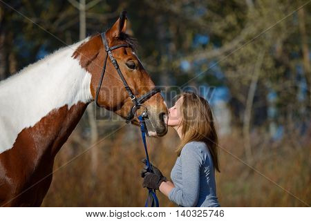 Girl Sportswoman And Her Horse In The Spring
