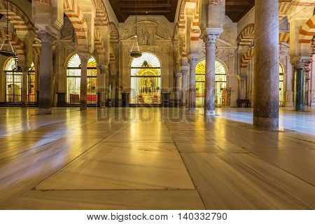 Cordoba, Andalusia, Spain - April 20, 2016: interior of the Great Mosque or Mezquita Catedral de Cordoba. Mezquita is a very popular tourist destination in Andalusia.