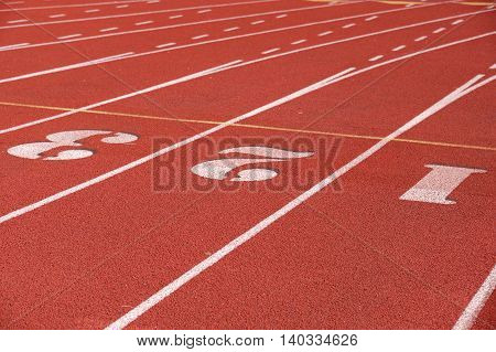 close up on red running track in sport field
