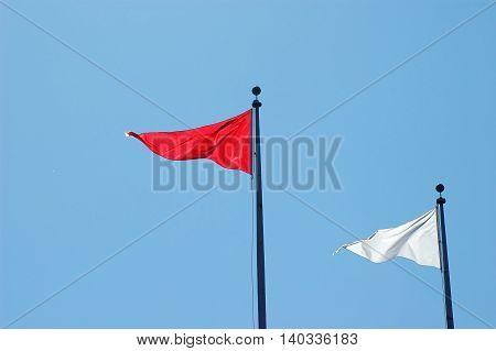 triangle flag against blue sky for design