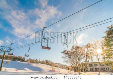 Sunset and  Ski lift going over the mountain