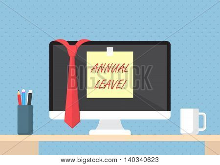 Sticky note with word annual leave on monitor vacation and holiday concept