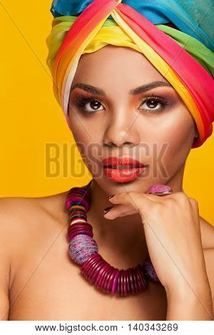 Girl With Afro American Ethnic Turban On Yellow Background