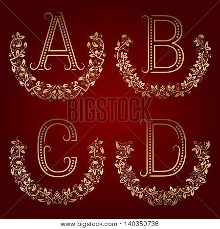 A B C D vintage monograms in floral wreaths. Set of golden letters in laurels.