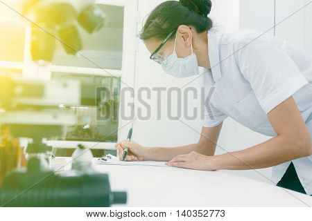 (science) Scientist Are Certain Activities On Experimental Science Like Mixing Chemicals, Microscope