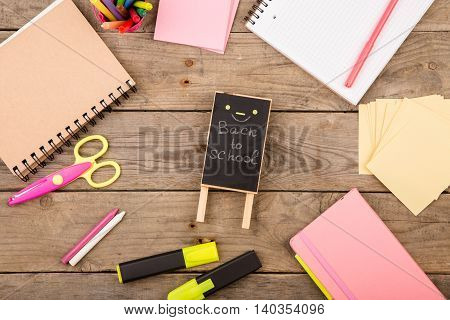 "Wooden Plaque With The Inscription ""back To School"" Near Notepads, Scissors And Other Stationery On"