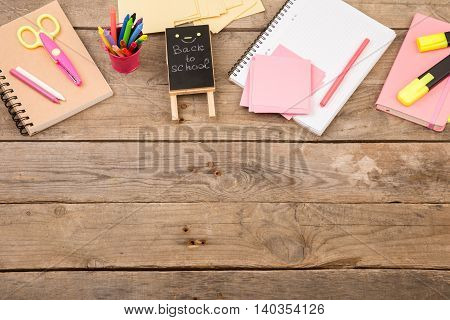 """Wooden Plaque With The Inscription """"back To School"""" Near Notepads, Scissors And Other Stationery On"""