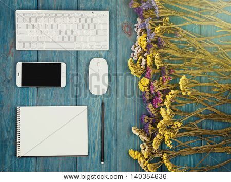 Slim Keyboard, Mouse, Smart Phone, Notepad, Colorful Flowers On Blue Wooden Desk