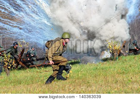 MOSCOW REGION - OCTOBER 13, 2013: Reenactors dressed as WW II soldiers at the Moscow Battle historical reenactment.