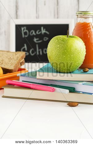 Back to school concept, lunchbox, apple and carrot juice. Selective focus