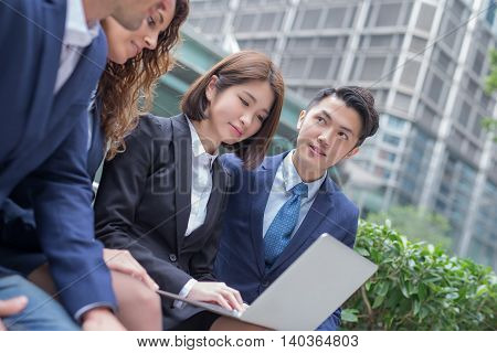 businesspeople are looking tablet and meeting shot in hongkong poster