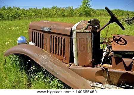 BARNESVILLE, MINNESOTA, June 19, 2016, The grill and steering wheel of an old Mack truck, a company founded in 10900, had it's first truck produced in 1907.