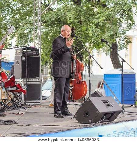 St. Petersburg, Russia - 23 July, Maestro at the microphone, 23 July, 2016. Speech by David Goloschekin with his jazz group on the Arts Square in St. Petersburg.