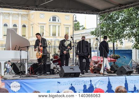 St. Petersburg, Russia - 23 July, Maestro with flowers on the stage, 23 July, 2016. Speech by David Goloschekin with his jazz group on the Arts Square in St. Petersburg.
