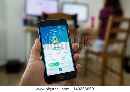 HONG KONG, CHINA, JULY 26, 2016 : Playing Pokemon Go on phone