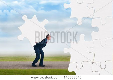 business puzzle concept businessman faces adversity to solve jigsaw