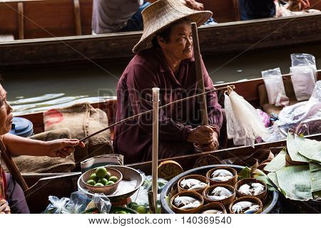 Damnoen Saduak Thailand-20 March 2016. Busy sunday morning at Damnoen Saduak floating marketRatchaburi Thailand place of locals selling fresh produce cooked food and souvenirs.