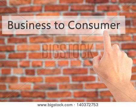 Business To Consumer - Hand Pressing A Button On Blurred Background Concept On Visual Screen.