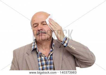 Elderly And The Sick Man Wipes The Sweat From His Forehead. To Be Ill During The Heat.