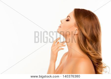 Sensitive Relaxed Woman Touching Her Neck On White Background