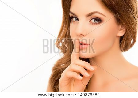 Pretty Woman Having Secret And Holding Finger On Lips