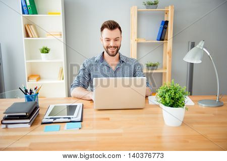 Portrait Of Cheerful Successful Businessman Working In Office On Laptop