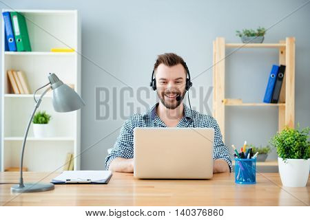 Portrait Of Bearded Happy Young Worker Of Call Center