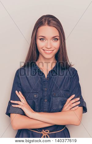 Young Happy Smiling Girl In Jean Dress With Crossed Hands