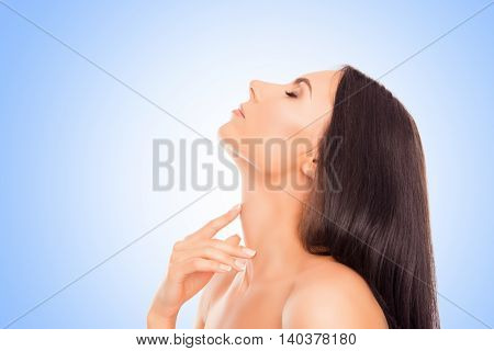 Sensitive Relaxed Woman Touching Her Neck On Blue Background