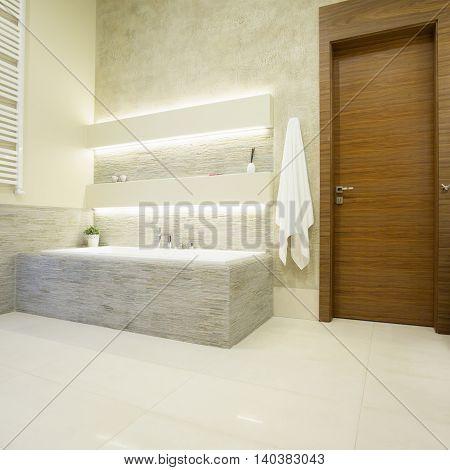 Picture of wooden entrance door to the luxury bathroom