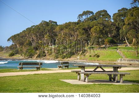 group of wooden bench and table near the sea at Lorne (a town on Great Ocean Road route) - can use for summer holiday travel concept