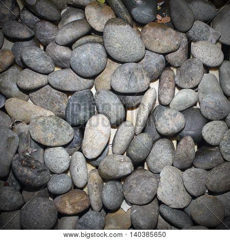 The black Sea stones on background texture