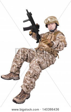 Soldier in uniform ready to fight. Isolated on white background.
