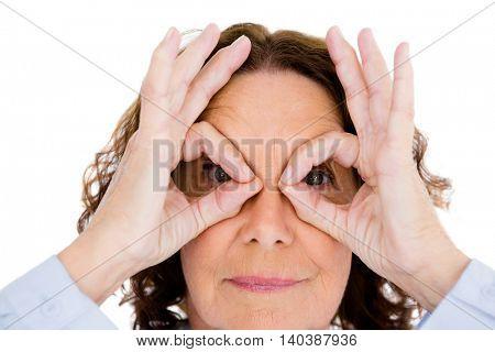Close-up portrait of curious mature woman against white background