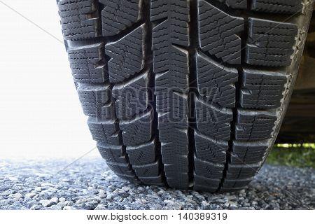 All year round car tire on dry asphalt in summer.
