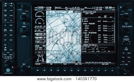 Airplane glass cockpit display with weather radar and engine gauges in small private airplane