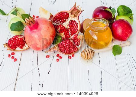 Apple and honey traditional food of jewish New Year - Rosh Hashana. Copy space background