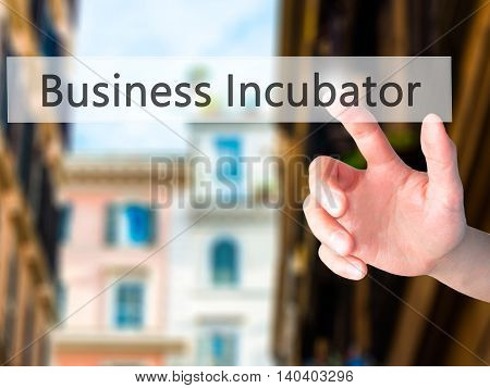 Business Incubator - Hand Pressing A Button On Blurred Background Concept On Visual Screen.