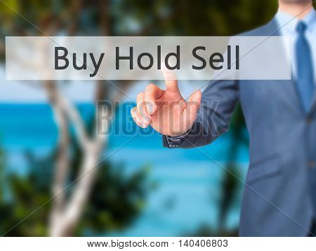 Buy Hold Sell -  Businessman Click On Virtual Touchscreen.
