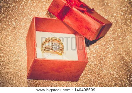 Golden Ring And Gift Box Retro