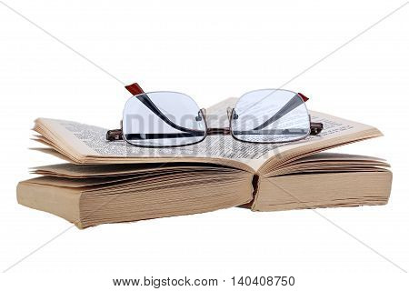 Open pocketbook and glasses isolated on white background with clipping path