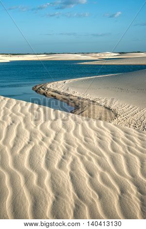 Lencois Maranhenses National Park Brazil low flat flooded land overlaid with large discrete sand dunes with blue and green lagoons