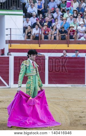 Sabiote Spain - August 23 2014: The Spanish Bullfighter Adrian de Torres bullfighting with the crutch in the Bullring of Sabiote Spain